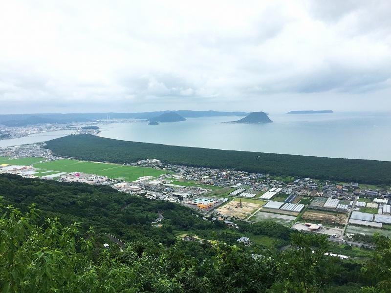 View of Karatsu Bay and Nijinomatsubara (pine forest along the Karastu Bay) from Kagamiyama Observatory.