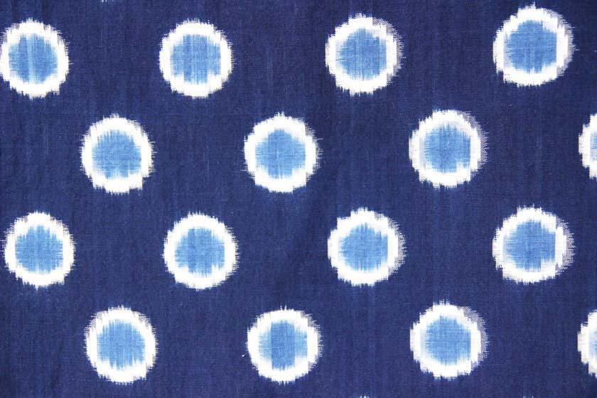 Kurume Kasuri by Takeshi Yamamura. The pattern is a circle made of white and light blue on indigo fabric.